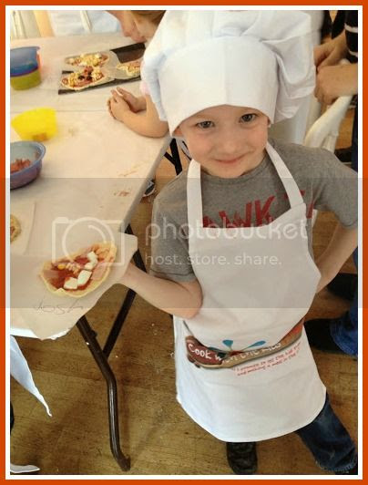 child making pizza