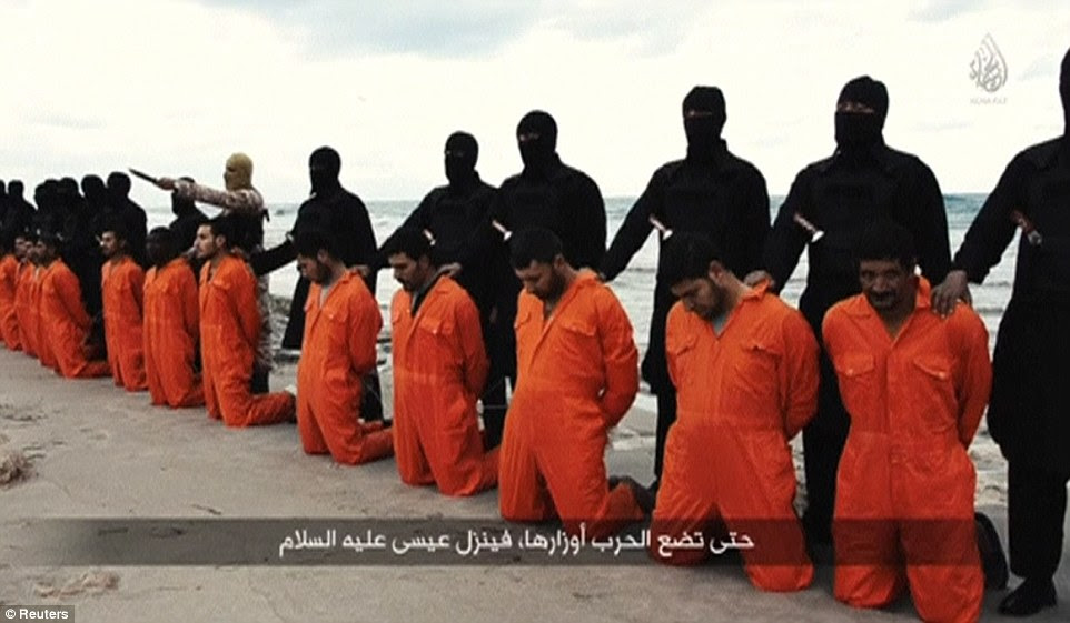 Horror: Released last night, a new video by ISIS showed the beheading of 21 Egyptian Coptic Christians on a beach in Libya