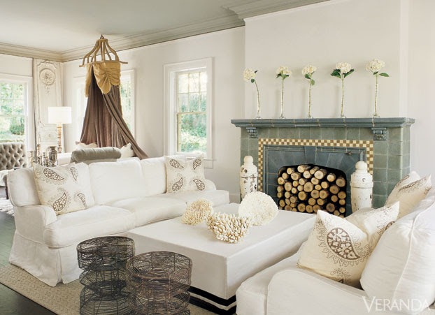 Antique nautical posts anchor 1920's tiled fireplace. Rachel Ashwell Shabby chic sofas and coffee table covered in Belgian linen.  Tucker Robbins wire stools. Ralph Lauren rug. Les Indiennes pillows. In corner, French panel, 19th-c.  INTERIOR DESIGN BY MARY CLARK WITH JESSICA HAWKINS