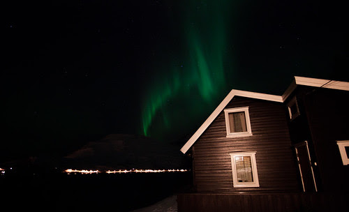Cabin surrounded by aurora