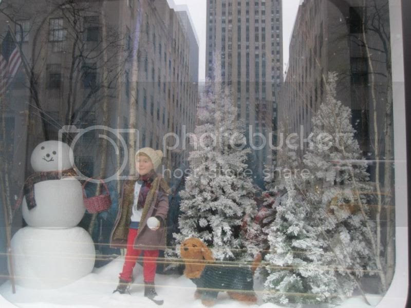 I can't remember which store this was. I think it was Saks.  It had little feathers floating all around.  It looked like snow but it doesn't show in the picture.