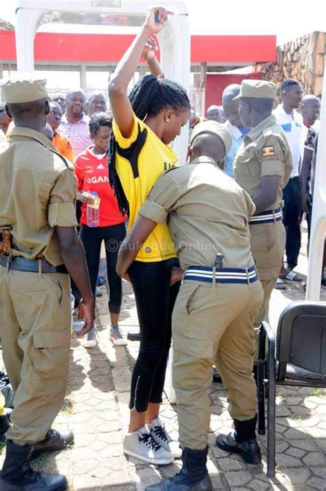 photo ugandan male police touching women  sensitive