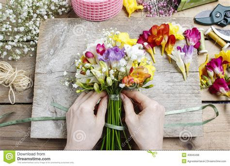 Florist At Work. Woman Making Bouquet Of Freesia Flowers