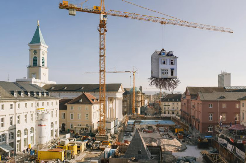 leandro erlich's house is pulled by the roots in karlsruhe