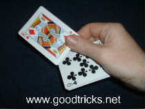 Push up card with thumb and hold with thumb and for finger.
