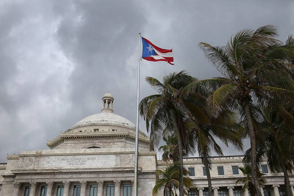 The Puerto Rican flag flies at the capitol building in San Juan.
