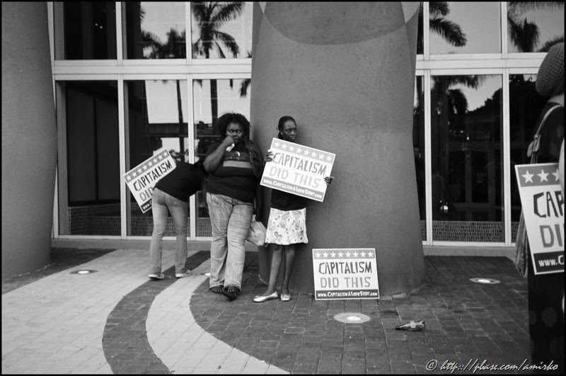 Street protesters at Biscayne boulevard in Miami, Florida, USA, 2009. Street Photography of Miami, San Francisco and Key West by Emir Shabashvili, see http://street-foto.com, http://miamistreetphoto.com, http://miamistreetphotography.com or http://miamistreetphotographer.com