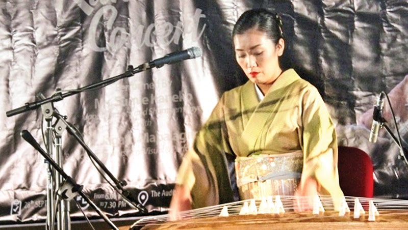 Sumie Kaneko playing a koto at the event.