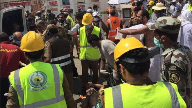 Photo posted on Twitter by Saudi Civil Defence Authority on 24 September 2015 showing medics treating man wounded in stampede at Hajj pilgrimage outside Mecca