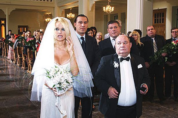 Pamela Anderson Wedding Dress / Pamela Anderson in White