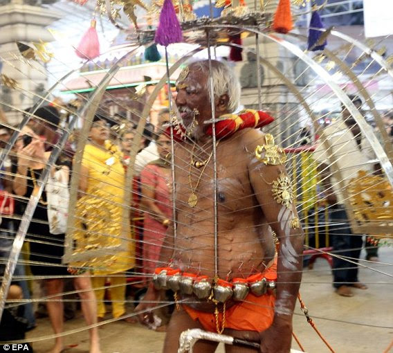 A devotee dances with his kadavi during the Thaipusam Festival