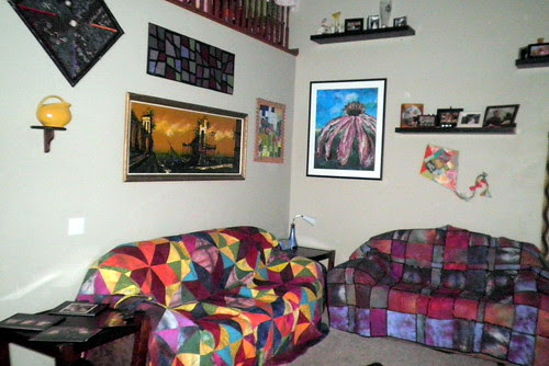Both of my couches with quilts on them