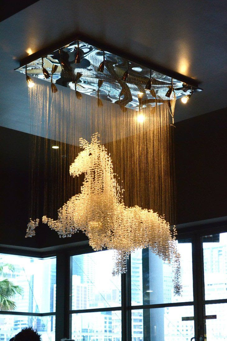 How cool would this horse chandelier be in your home or a restaurant?