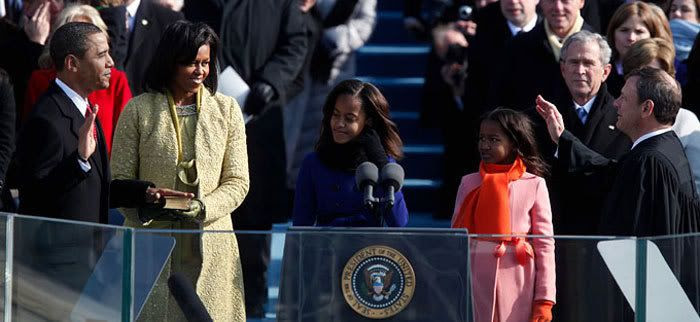 Barack Obama's wife and two daughters, plus George W. Bush in the background, look on as Obama is sworn in as the 44th President of the United States, on January 20, 2009.