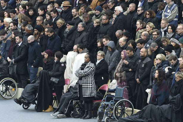 "People wounded in the Paris terror attacks attend the ""national and republican"" tribute, a solemn ceremony in honour of the 130 people killed in the November 13 Paris attacks"