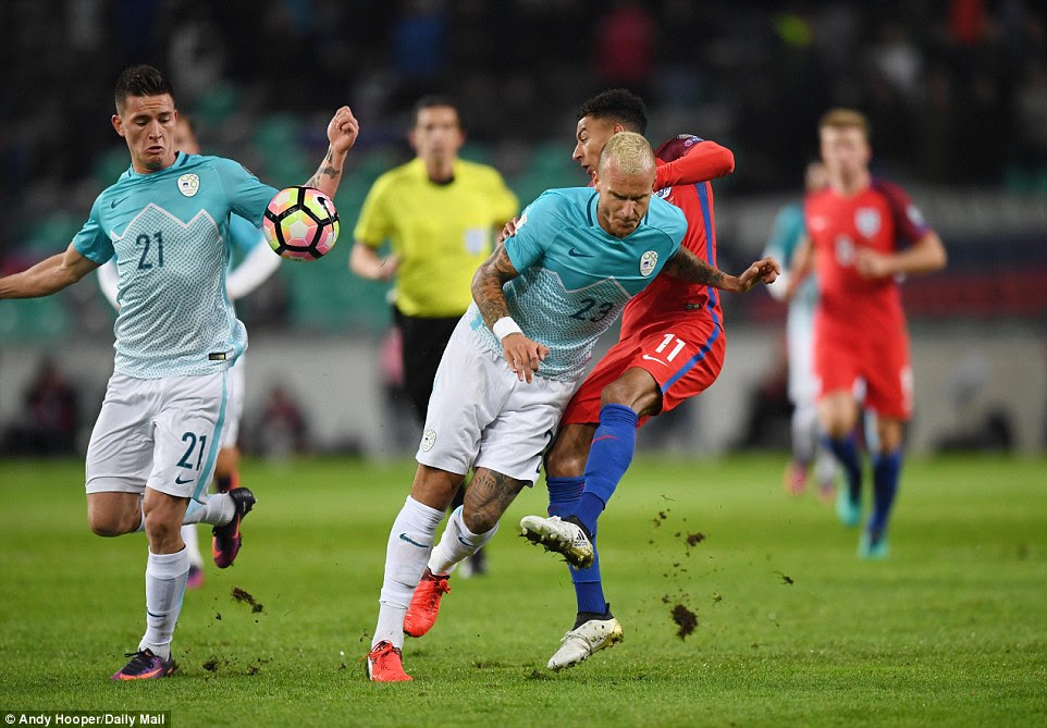 Jesse Lingard (right) battles withAljaz Struna (centre) andBenjamin Verbic during a first-half stalemate in Ljubljana
