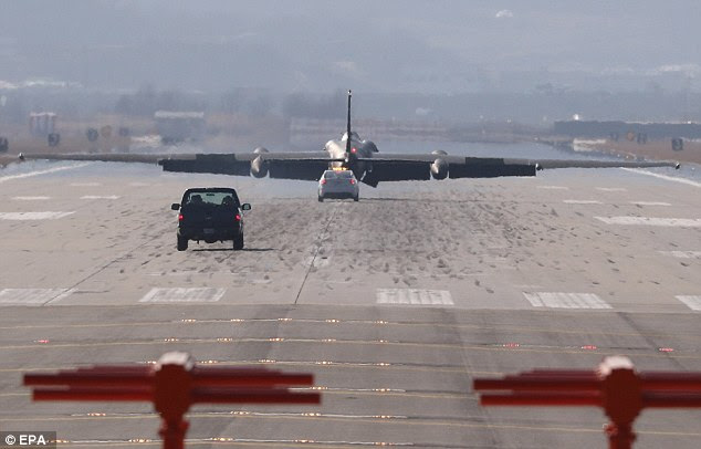 The attack by North Korea comes as global condemnation of the regime swelled. Pictured: A US Air Force reconnaissance aircraft landing at Osan Air Base near Seoul, South Korea, on March 6