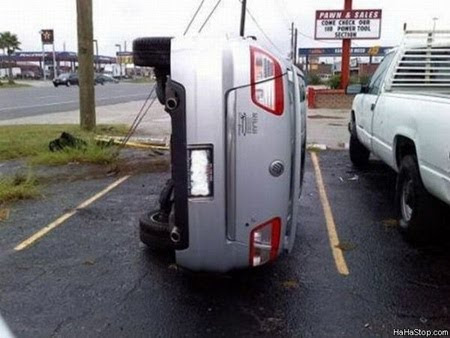 photo of a car parked on its side
