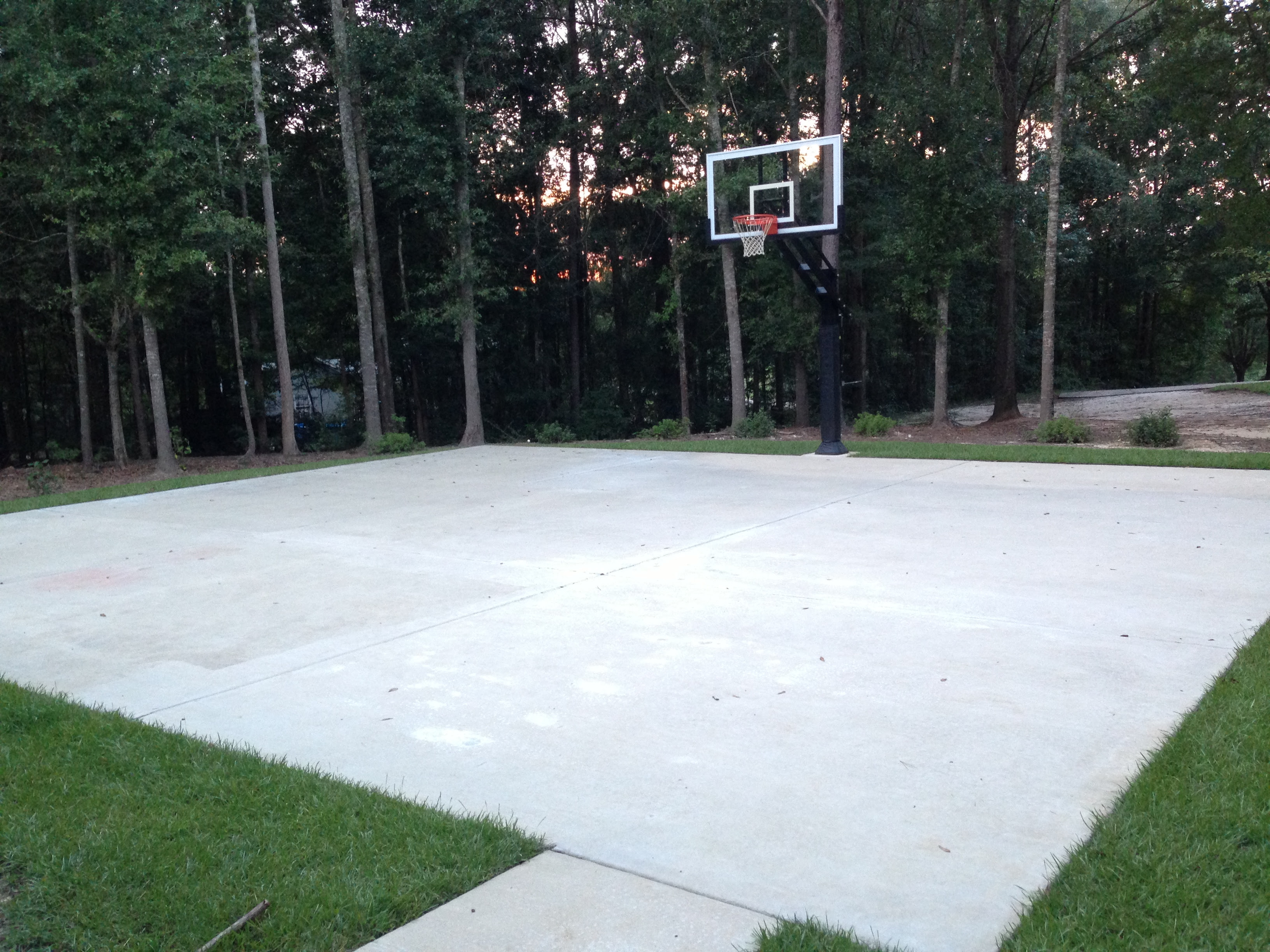 There Is His Large Concrete Slab Court And You Can See His Pro Dunk
