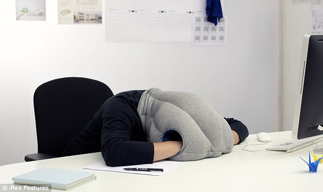 A cheeky work nap: The pillow is designed to give people a place to rest their hands and heads while they snooze - but it might attract the attention of the boss
