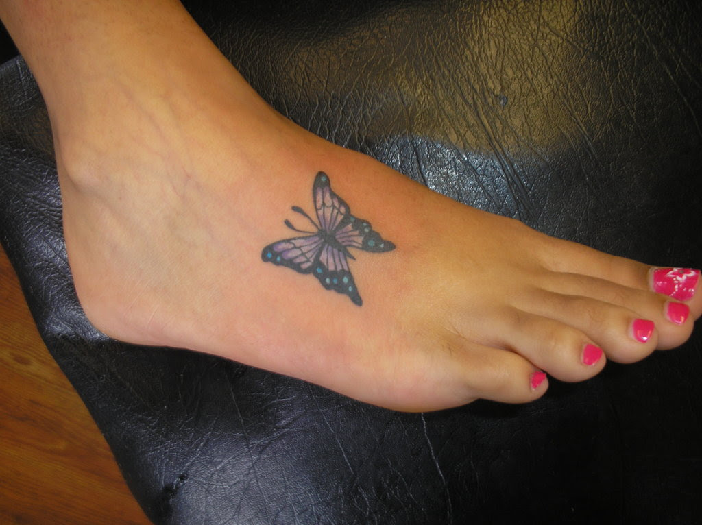 Girl With Butterfly Foot Tattoo