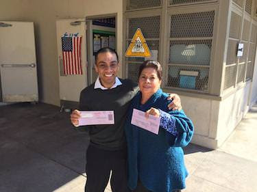 LAUSD school board candidate Ref Rodriguez and his mother outside a polling station yesterday. (Via Twitter @DrRefRodrguez)
