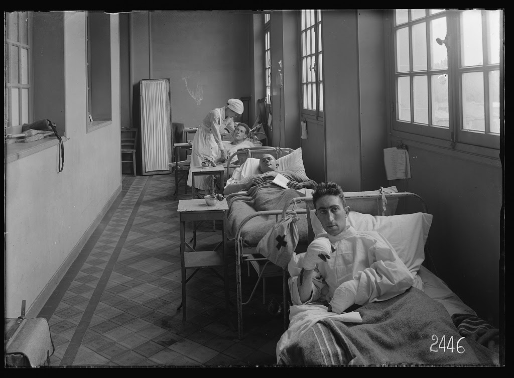 Scene in the corridor military hosp. Photo by Lewis Wickes Hine, 14 June 1918. //hdl.loc.gov/loc.pnp/anrc.06729