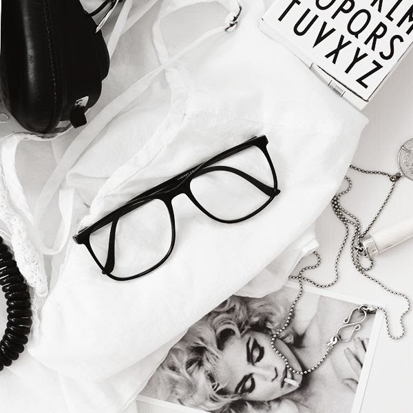 LE FASHION BLOG HOME DECOR INSPIRATION MIJA THE SUPER ORDINARY SWEDISH INTERIOR DESIGN BLOGGER BLACK AND WHITE FASHION RELATED DETAILS NECKLACE MADONNA NECKLACE BLACK FRAMES EYEGLASSES WHITE TEE 2 photo LEFASHIONBLOGHOMEDECORINSPIRATIONMIJATHESUPERORDINARY2.jpg