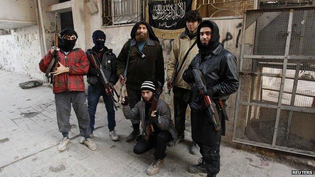 Members of the Al-Nusra Front - part of al-Qaeda - which has recruited British jihadists, here in Aleppo