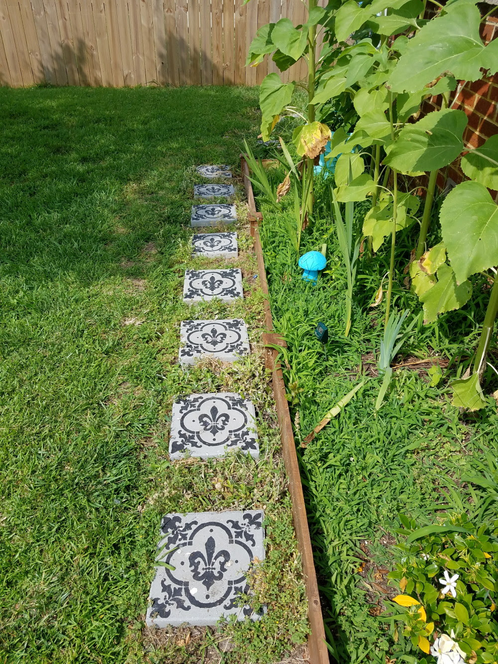 Yard stones painted to have a cement tile look. A boho garden in progress. @adesignerathome