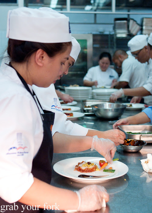 CCA Manila chef plating a Dutch baby carrot at the Filipino Barbie