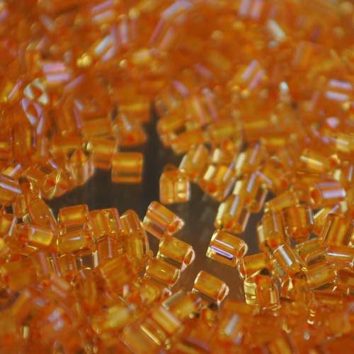 tb11t950 Japanese Seedbeads - 11/0 Toho Triangles - Colour Lined Burnt Orange/Jonquil