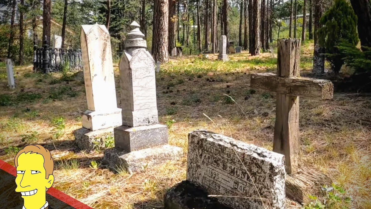 historic stone, marble and wooden gravestones resting in the grass at Lytton Pioneer Cemetery