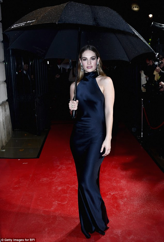 Drenched! Lily James still maintained a stunning red carpet appearance despite the teaming rain at the BFI Awards on Saturday night