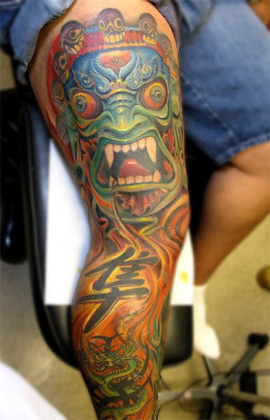 colorful tattoos on dark skin