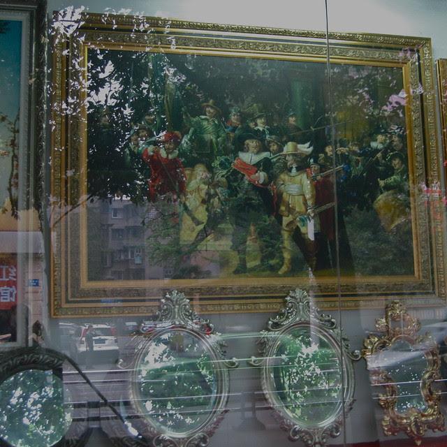 Rembrandt's Night Watch, (replica in a store window) Chengdu