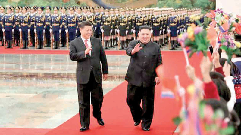 Chinese President Xi Jinping and North Korean leader Kim Jong Un a welcome ceremony at Beijing's Great Hall of the People.