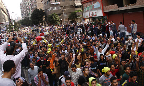 Egyptians demonstrate against the new law imposed by the military-backed regime restricting protests. Thousands have been arrested since the July 3 coup. by Pan-African News Wire File Photos