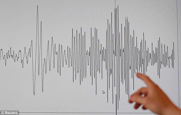 Seismic shake: A technician at the French National Seism Survey Institute points at a graph pinpointing the moment the earthquake struck