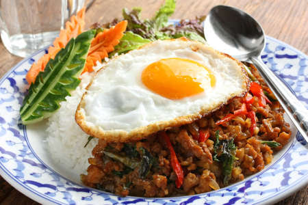 stir fried chicken with holy basil , gai pad bai gaprow , thai cuisine Stock Photo - 10710316
