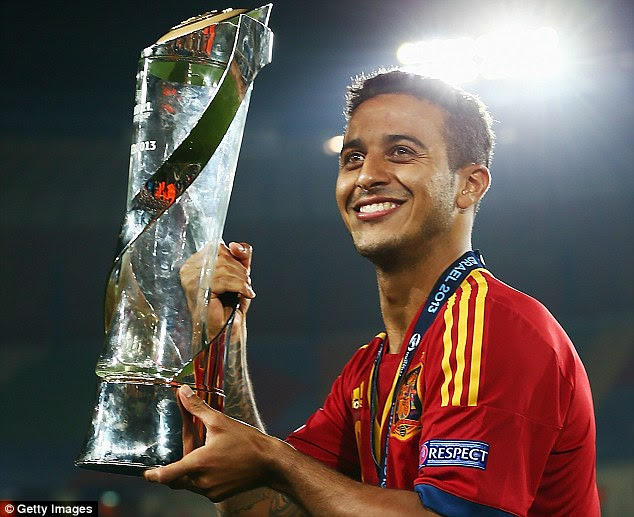 In demand: Thiago Alcantara, with the U21 Euros trophy, has agreed terms with Manchester United