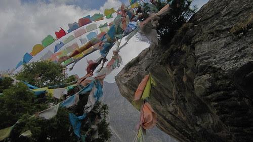 Prayer flags, wind.  Paoma Shan, Kanding