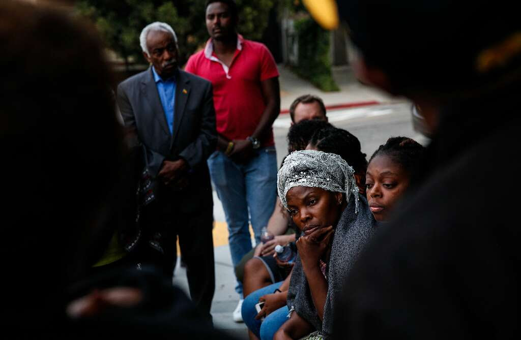 Nadege Nadege listens at a candlelight vigil for Yonas Alehegne, an Ethiopian immigrant who was shot and killed by an Oakland police officer in August, in Oakland, Calif., on Sunday, September 13, 2015. Photo: Sarah Rice, Special To The Chronicle