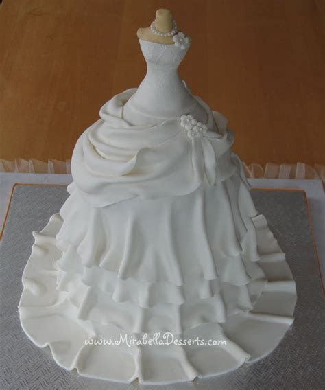 A 4 tier wedding dress cake made for a recent bridal