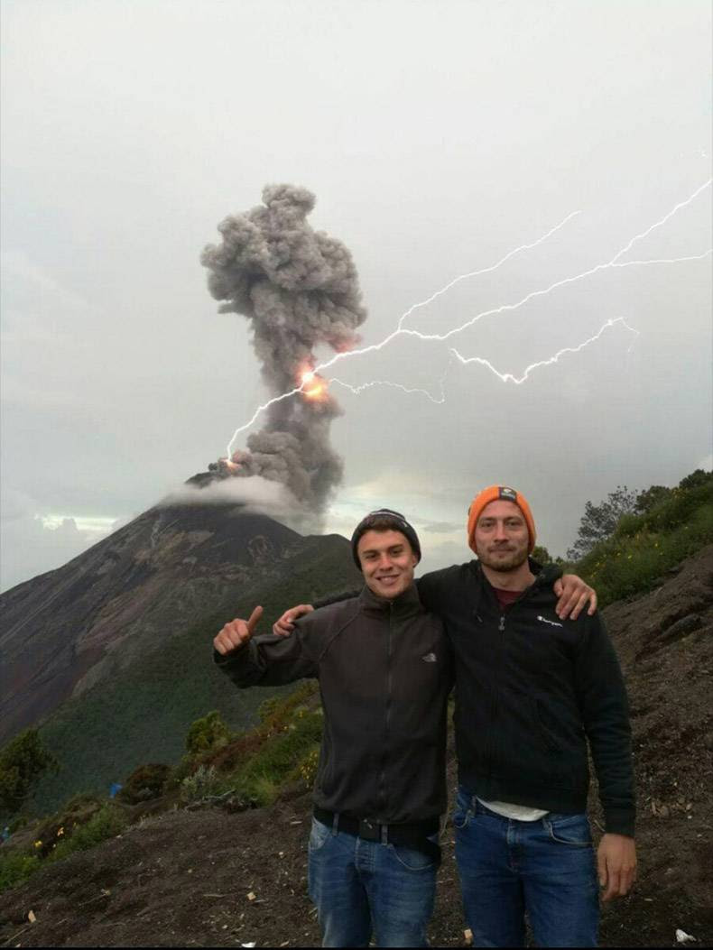 13 - Bros hanging out and taking pic in front of exploding volcano