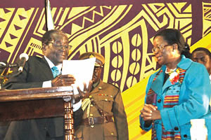 President Mugabe receives the Broad Based Women's Economic Empowerment Framework document from Women's Affairs, Gender and Community Development Minister Olivia Muchena in Harare on July 19, 2012. by Pan-African News Wire File Photos