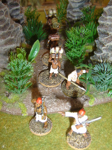 Porters move through jungle