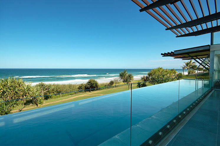 Beach Style Pool by Skale Building Design