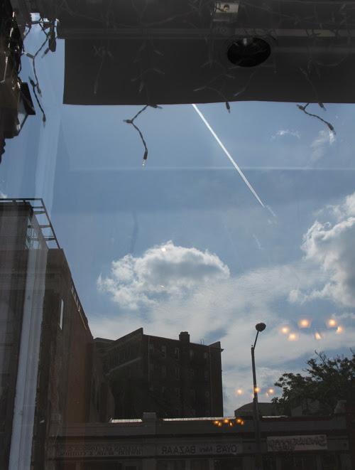 lots to see reflected in an Adams Morgan window, Washington, D.C.