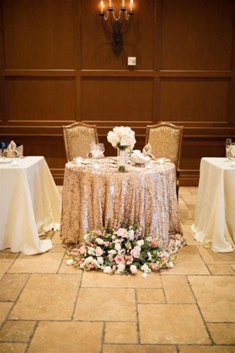 Glam, vintage sweetheart table with a sequin gold table